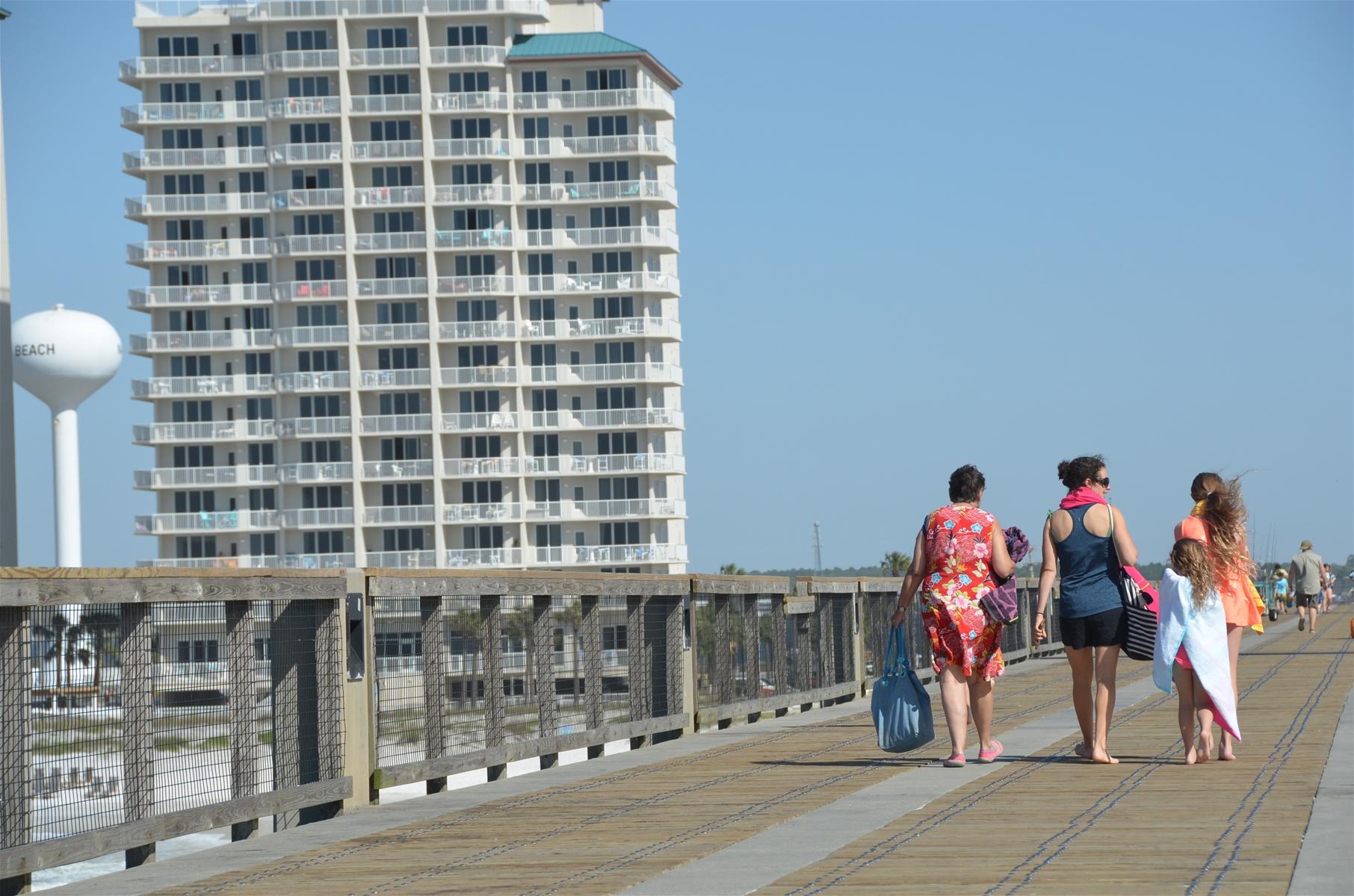 walking on navarre beach pier